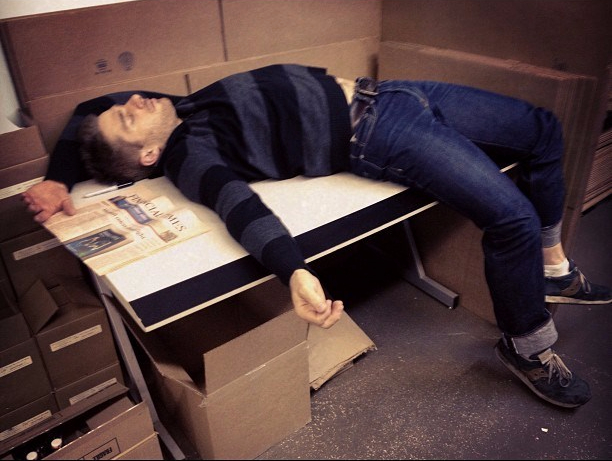Matt sleeping on the shipping table circa 2010